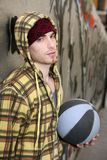 Grunge basket ball street player on brickwall Stock Photography