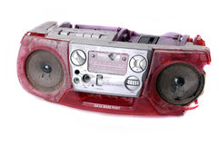 Grunge battered boombox. A heavily battered and broken portable stereo unit, assaulted and disabled by marauding MP3 players Royalty Free Stock Image