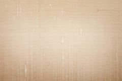 Grunge beige silk texture. Grunge beige silk fabric can serve as background Stock Photo