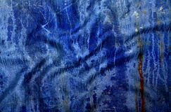 Grunge bevlekte blauwe doektextuur Stock Foto's