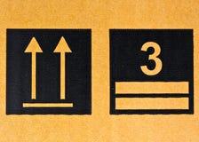 Grunge black fragile symbol. Image close-up of grunge black fragile symbol on cardboard royalty free stock photos