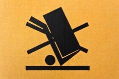 Grunge black fragile symbol. Image close-up of grunge black fragile symbol on cardboard stock photos
