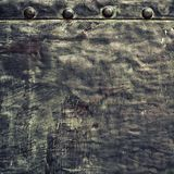 Grunge black metal plate with rivets screws background texture Stock Images