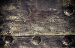 Grunge black metal plate with rivets screws background texture Stock Image