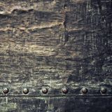 Grunge black metal plate with rivets screws background texture Stock Photo