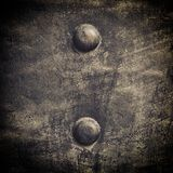 Grunge black metal plate with rivets screws background texture Stock Photos