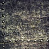 Grunge black metal plate with rivets screws background texture Royalty Free Stock Images