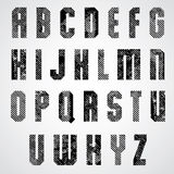 Grunge black rubbed capital letters, decorative striped font on Royalty Free Stock Photo