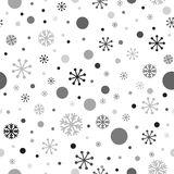 Grunge black snowflakes on the white background. Seamless winter time pattern. Stock Photography