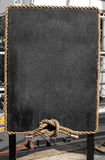 Grunge blackboard with rope frame Royalty Free Stock Photography