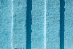 Grunge blauer gemalter Wand-Beschaffenheitshintergrund Stockfotos