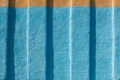 Grunge blauer gemalter Wand-Beschaffenheitshintergrund Lizenzfreie Stockfotos
