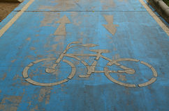 Grunge blue bicycle lane Stock Photos