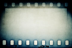 Grunge blue brown film strip background. Royalty Free Stock Photography