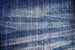 Grunge blue denim background, old, faded, vintage, retro, pants, close-up, natural fabric, rough cotton fabric, canvas, fashion,. Abstract background blue stock photo