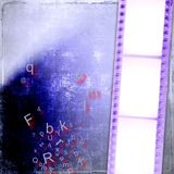 Grunge blue film strip background. And written Stock Photo