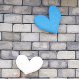 Grunge blue heart on grey brick wall Stock Photos