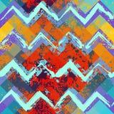 Grunge blue and orange chevron pattern. Stock Images