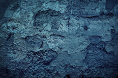 Grunge blue wall. Grunge blue painted cracking wall concrete texture background Stock Image