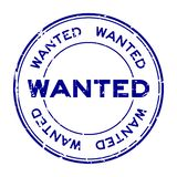 Grunge blue wanted round rubber stamp on white background stock photography