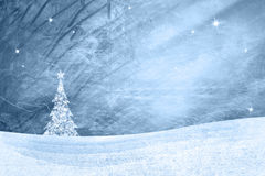 Grunge blue winter landscape with xmas tree Stock Photography