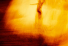 Grunge Blur: Man in Fire. Amazingly this photo started out as a long exposure of a surfer at sunset -- the blur of the water and the intense sun lent itself to a Royalty Free Stock Photos