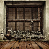 Grunge boarded up window and wooden floor Stock Photography