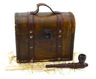 Grunge box with smoking pipe. Old shabby box with smoking pipe and straw isolated Stock Photos