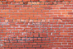 Grunge brick wall. Grunge brick wall laid with a red brick Stock Image
