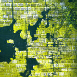 Grunge brick wall. Cracks and delamination of the brick wall Royalty Free Stock Images