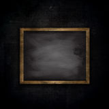 Grunge brick wall background with chalkboard Royalty Free Stock Image