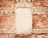 Grunge brick wall with blank frame Royalty Free Stock Photos
