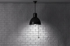 Grunge Brick Wall and Ceiling Lamp Royalty Free Stock Photo