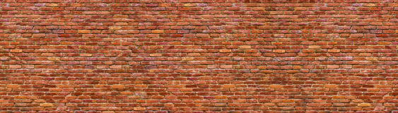 Grunge brick wall, old brickwork panoramic view. Panoramic view of masonry, brick wall as background stock image