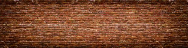 Grunge brick wall, old brickwork panoramic view. Panoramic view of masonry, brick wall as background Royalty Free Stock Photos
