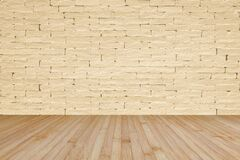 Free Grunge Brick Wall Painted In Light Yellow Beige With Wooden Floor In Yellow Brown For Interior Backgrounds Royalty Free Stock Image - 186081866