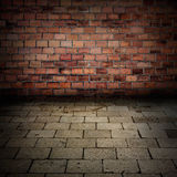 Grunge brick wall with sidewalk floor interior stock image