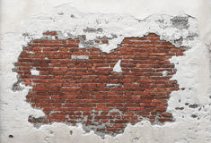 Grunge Brick Wall Texture. Grunge Destroyed Brick and Concrete Wall on an Old Building in Italy stock photos