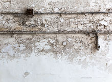 Grunge brick wall with wiring. Royalty Free Stock Photo