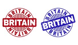 Grunge BRITAIN Textured Round Watermarks. Grunge BRITAIN round stamp seals isolated on a white background. Round seals with grunge texture in red and blue colors royalty free illustration
