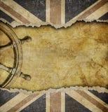 Grunge British flag and old steering wheel Royalty Free Stock Image