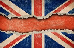 Grunge British flag on ripped or torn paper royalty free stock images
