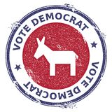 Grunge broken democrat donkeys rubber stamp. USA presidential election patriotic seal with broken democrat donkeys silhouette and Vote Democrat text. Rubber Stock Photo