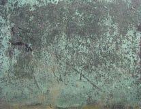 Grunge bronze surface in black blue green Stock Photos