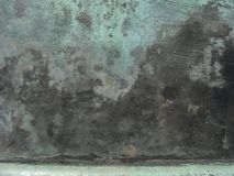 Grunge bronze surface in black blue green Stock Images
