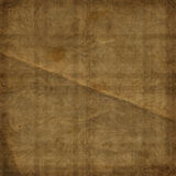 Grunge brown background with ancient ornament. Royalty Free Stock Image