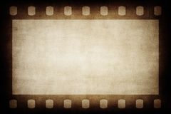 Grunge brown film strip background. Stock Image