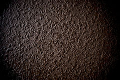 Grunge brown grained wall background or texture. Closeup of grunge grained wall stock photos