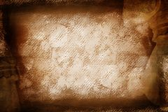 Grunge brown painted canvas. Dark faded brown painted sheet with spots and marks on canvas texture Royalty Free Stock Photo