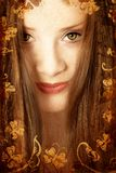 Grunge brunette woman. Brunette woman with long hair and green eyes on swirls and scrolls grunge swirls background with butterflies, paper grain Royalty Free Stock Photography